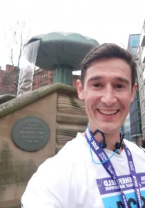 Trainee Financial Planner James Fisher with his medal after the Sheffield Half Marathon 2018, looking happy that the planning and hard work paid off.